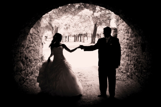 wedding photograph, bride, groom in a tunnel
